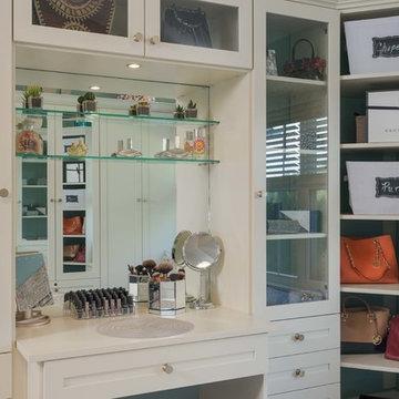 Chic Walk-In Closet Wiht Built In Vanity and Lighting