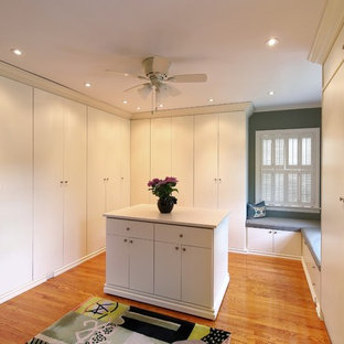 Dressing room - huge transitional gender-neutral medium tone wood floor and brown floor dressing room idea in Chicago with flat-panel cabinets and white cabinets