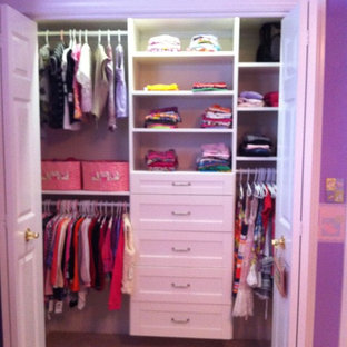 Reach-in closet - mid-sized traditional women's carpeted reach-in closet idea in Chicago with white cabinets