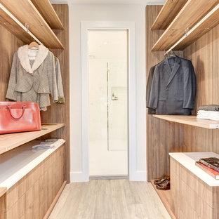 Walk-in closet - mid-sized modern medium tone wood floor and gray floor walk-in closet idea in DC Metro