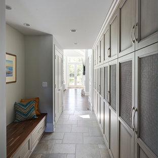 Foto de armario vestidor unisex, tradicional renovado, grande, con armarios con paneles empotrados, puertas de armario grises y suelo de baldosas de porcelana