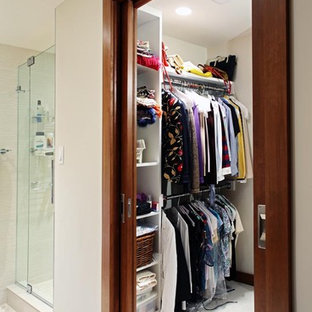 This is an example of a medium sized contemporary gender neutral walk-in wardrobe in DC Metro with open cabinets, white cabinets and ceramic flooring.