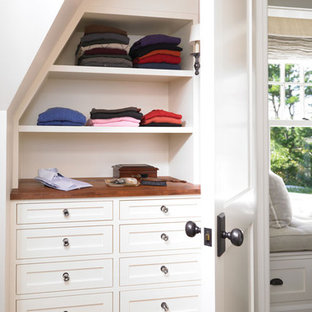Inspiration for a timeless medium tone wood floor closet remodel in Boston