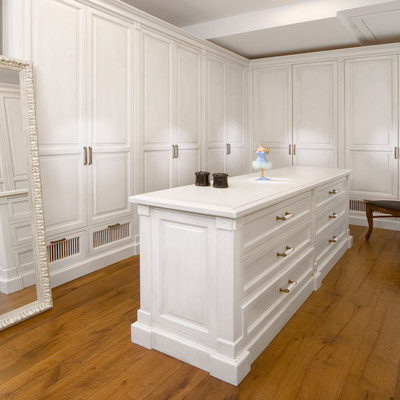 Trendy dressing room photo in Other with white cabinets