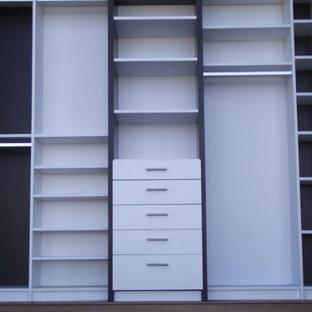 Inspiration for a contemporary closet remodel in Miami