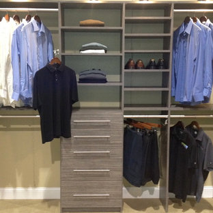 Small elegant gender-neutral reach-in closet photo in Jacksonville with gray cabinets
