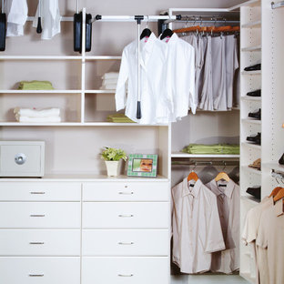 Example of a large trendy gender-neutral carpeted dressing room design in Other with raised-panel cabinets and white cabinets