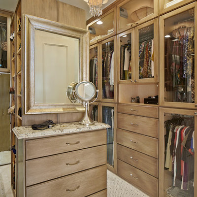 Inspiration for a timeless dressing room remodel in Dallas with medium tone wood cabinets