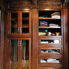 Traditional Closet by Marius Daugvila