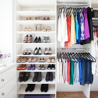 Inspiration for a contemporary women's medium tone wood floor walk-in closet remodel in San Diego with open cabinets and white cabinets