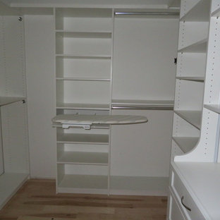 Example of a small transitional gender-neutral light wood floor and beige floor walk-in closet design in Philadelphia with open cabinets and white cabinets