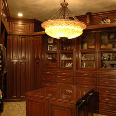 Traditional Closet by Cabinets & Designs