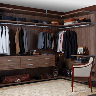 Closet - mid-sized contemporary gender-neutral carpeted closet idea in Santa Barbara with open cabinets and medium tone wood cabinets