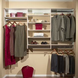 Example of a small transitional gender-neutral medium tone wood floor reach-in closet design in Phoenix with open cabinets and white cabinets