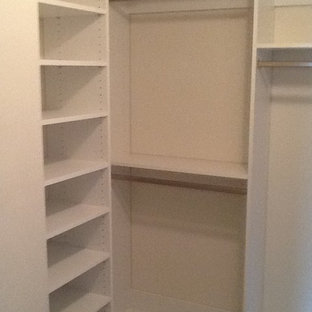 Large traditional gender-neutral walk-in wardrobe in Richmond with white cabinets and open cabinets.