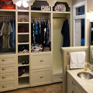 Design ideas for a small classic gender neutral standard wardrobe in Austin with open cabinets, beige cabinets, travertine flooring and brown floors.