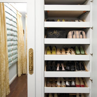 Closet - traditional women's dark wood floor closet idea in Detroit with open cabinets and white cabinets
