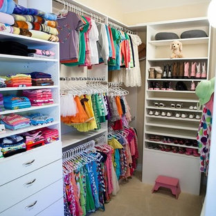 Walk-in closet - mid-sized modern women's carpeted walk-in closet idea in Denver with open cabinets and white cabinets