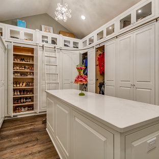 Walk-in closet - traditional women's dark wood floor and brown floor walk-in closet idea in Cleveland with raised-panel cabinets and white cabinets
