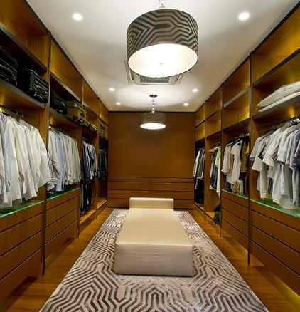 Contemporary Closet by DESIGN INTERVENTION
