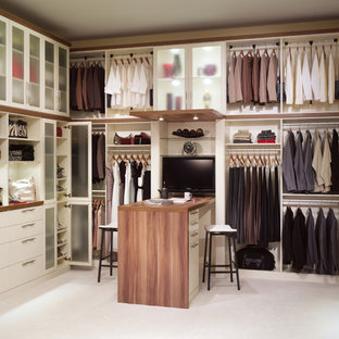 Inspiration for a large contemporary gender-neutral carpeted dressing room remodel in Denver with open cabinets and white cabinets