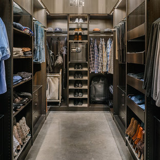 Inspiration for a contemporary men's dressing room in Vancouver with concrete floors.