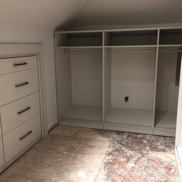 Contemporary Master Closet in high-gloss white and linen finish