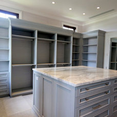 Transitional Closet by Planning and Building, Inc