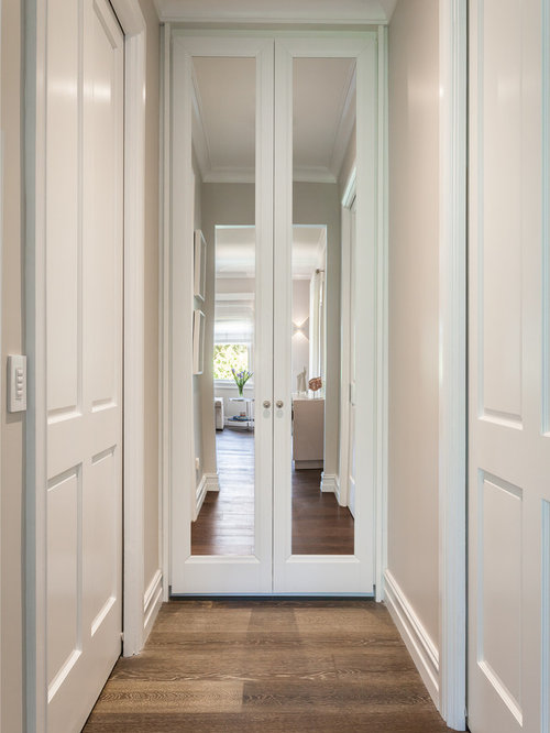 Inspiration For A Large Timeless Gender Neutral Dark Wood Floor Walk In  Closet Remodel