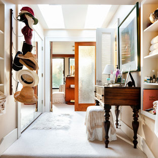 Inspiration for a timeless dressing room remodel in Austin with open cabinets and beige cabinets