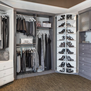 Mid-sized elegant women's carpeted and multicolored floor walk-in closet photo in Chicago with flat-panel cabinets and gray cabinets