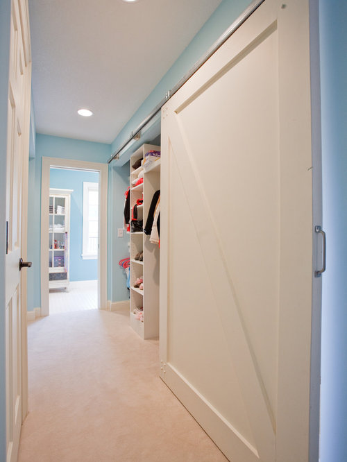 Example Of A Classic Carpeted Hallway Design In Minneapolis With Blue Walls