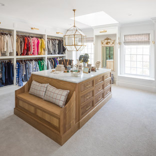 Inspiration for a timeless women's carpeted and gray floor dressing room remodel in Salt Lake City with recessed-panel cabinets and medium tone wood cabinets