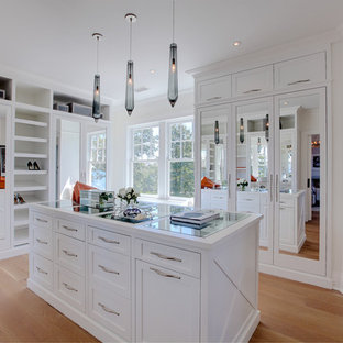Large coastal women's light wood floor and beige floor dressing room photo in Other with white cabinets and shaker cabinets