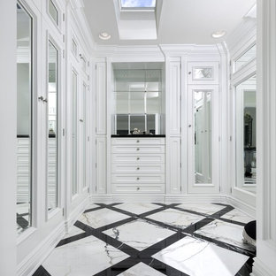 Example of a classic gender-neutral multicolored floor dressing room design in Los Angeles with recessed-panel cabinets and white cabinets