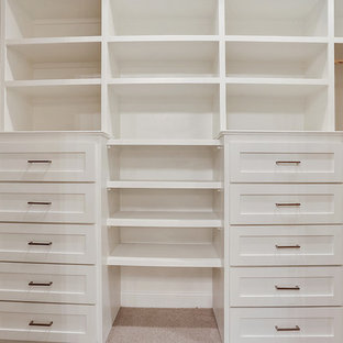 Country walk-in wardrobe in New Orleans with shaker cabinets, white cabinets and carpet.