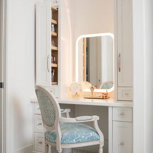 This is an example of a large transitional women's walk-in wardrobe in Atlanta with white cabinets, carpet, grey floor and recessed-panel cabinets.