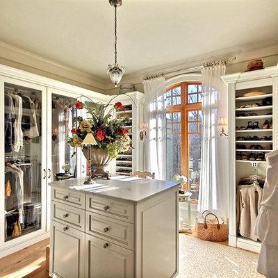 Elegant light wood floor dressing room photo in Atlanta with white cabinets