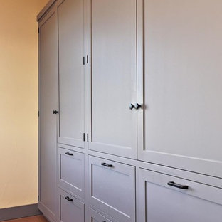 Inspiration for a large timeless women's reach-in closet remodel in Vancouver with shaker cabinets and white cabinets