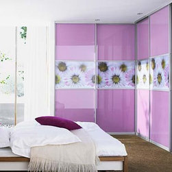 """Raumplus - """"Lavender"""" - """"Lavender"""" Raumplus glass panels are accented with a strip of a custom daisy pattern creating this dreamy purple paradise. Doors meet seamlessly at the corner making what may have been a corner to toss clothes - useful organized shelving. Shaggy carpet is still possible due to Raumplus tracks designed to keep the wheels secure within the channel."""