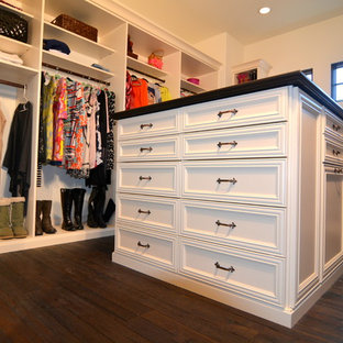Example of a large classic women's dark wood floor and brown floor walk-in closet design in Tampa with recessed-panel cabinets and white cabinets