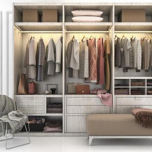 Foto di uno spazio per vestirsi design di medie dimensioni con ante lisce, ante grigie, pavimento in cemento e pavimento bianco
