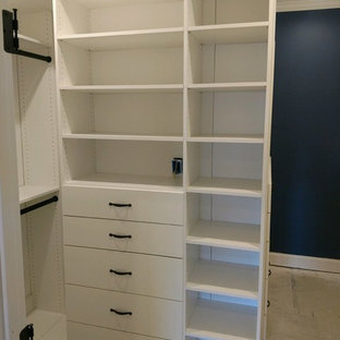 This is an example of a small contemporary gender-neutral walk-in wardrobe in Louisville with open cabinets, white cabinets, concrete floors and brown floor.