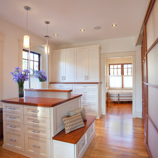 Classic dressing room in DC Metro with white cabinets, shaker cabinets and medium hardwood flooring.