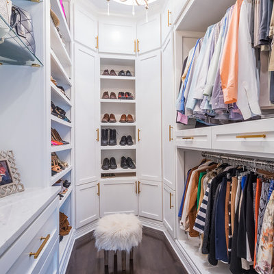 Example of a transitional gender-neutral dark wood floor and brown floor walk-in closet design in Houston with open cabinets and white cabinets