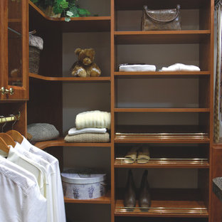 Inspiration for a mid-sized timeless men's carpeted and green floor walk-in closet remodel in Charleston with open cabinets and dark wood cabinets