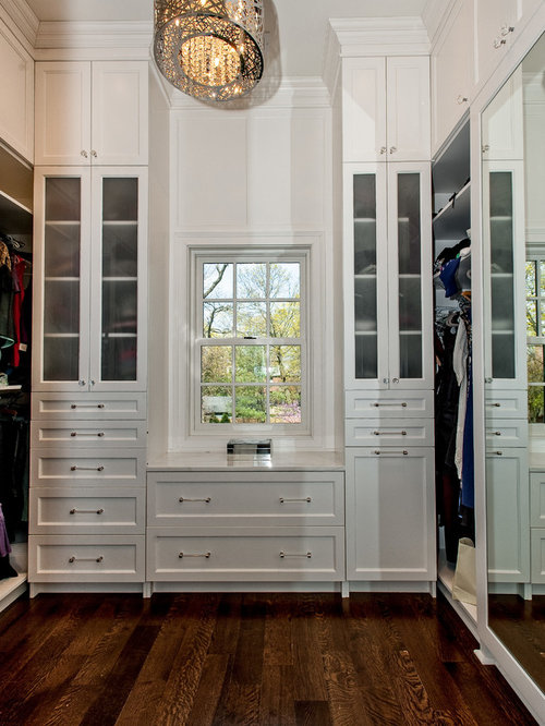 transitional walk in closet photo in chicago with white cabinets - Luxury Closets