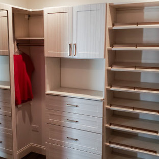 Custom master closet with full length mirror cabinet & matte gold hardware!