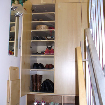 Custom mudroom storage shelves and fold down bench
