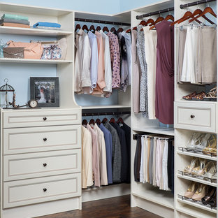 Photo of a victorian storage and wardrobe in Other with white cabinets.